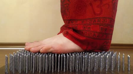 barefooted : stand on the nails Stock Footage