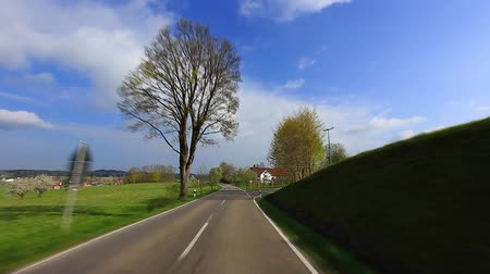 enjoynment : Driving a car on a sunny road under a blue sky