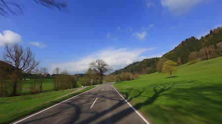 Driving a car on a sunny road under a blue sky