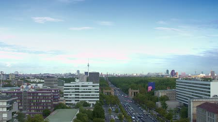 Traffic on Strasse des 17. Juni, view on Tiergarten and the Skyline of Berlin.