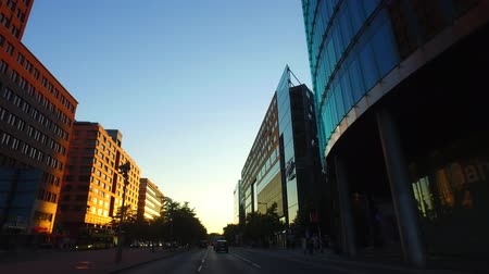 Berlin, Berlin  Germany, POV Car Driving at Berlin Mitte at Sunset, passing Potsdamer Platz. Gyro-stabilized camera. Stock Footage