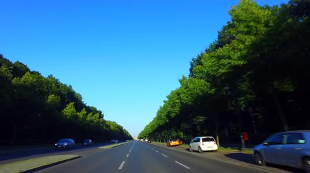 Berlin, Germany: Car Driving on Strasse des 17. Juni, Berlin, heading toward Siegessäule. Gyro-stabilized Camera. Stock Footage