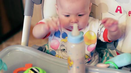 infant formula : Mom feeds the baby special food in the bottle