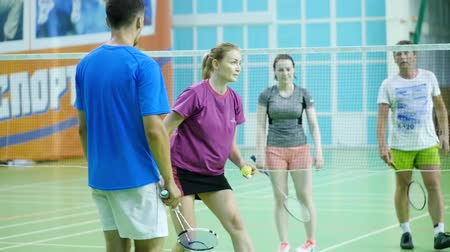 ütő : Russia, Novosibirsk, December 29, 2018. Athletes train in indoor badminton courts