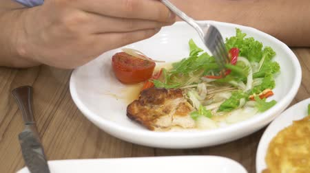 shallot : Thai cuisine - rice, omelet, vegetables with pork. a man eats Thai food in a restaurant. 4k, slow motion Stock Footage