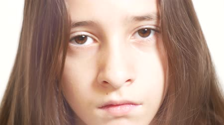haughty : Young sad girl looks at the camera. 4k