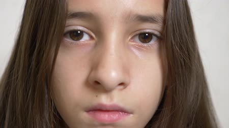 haughty : Young sad girl looks at the camera. 4k. Slow motion Stock Footage