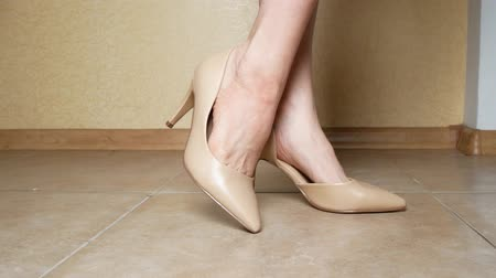 high heels : close-up. female legs in creamy high-heeled shoes. indoors. 4k Stock Footage