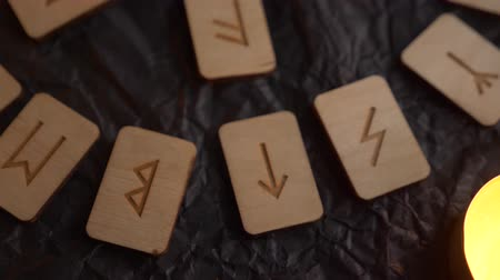 vikings : Wooden rune wheel. runic layout and candles, 4k, slow-motion shooting