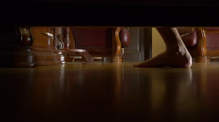 get out : man feet under the bed, walking in the room