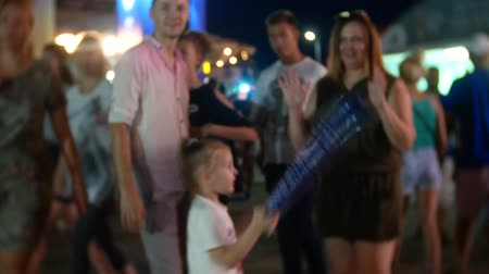 SOCHI, RUSSIA - June 15, 2018: FIFA 2018. The fans in the seaport are happy with the live broadcast of the game. family with a child on a national celebration. 4k