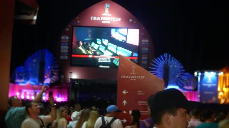 haziran : SOCHI, RUSSIA - June 15, 2018: FIFA 2018. broadcast the game on the screen in the seaport. fans are watching the live broadcast of the game. Stok Video