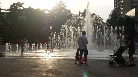 SOCHI, RUSSIA - June 15, 2018. Children play in the citys fountain on a summer day. 4k. Stock Footage