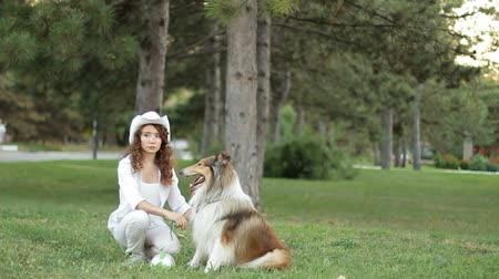 slowing : Girl with a collie dog. Slow motion. Stock Footage
