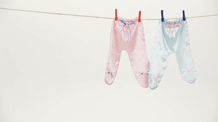 crawlers : Two pairs of laundry hanging on a drying rope