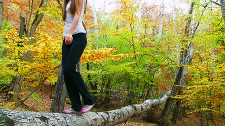 günlüğü : Two frames: beautiful young girl is walking on the log.