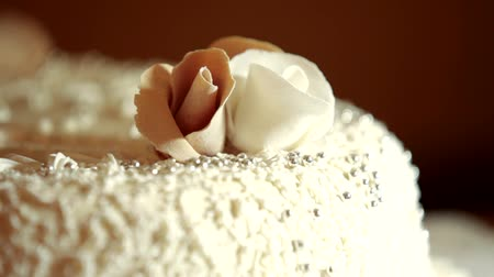 tiered : A beautiful wedding cake with flower of cream. Change lighting.