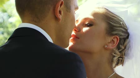 weddings : Newlyweds kissing at a romantic nature. Three frames. Video editing.