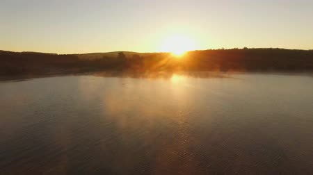 wavelet : AERIAL VIEW. This is a picturesque view - beautiful sunset at water reservoir covered with haze fog over it. Stock Footage