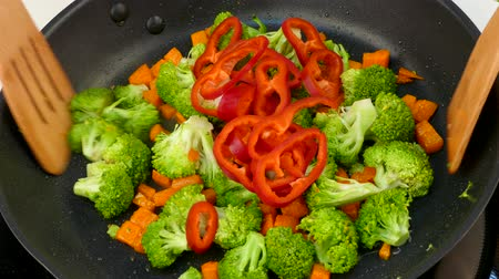 fry vegetables in oil in a frying pan