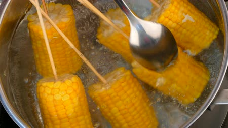 salt corn in a saucepan