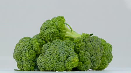 Broccoli spinning on a white background Stok Video
