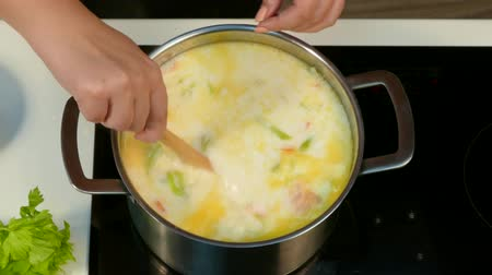 zeller : Add grated cheese to soup, stirring