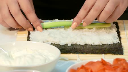 soya : On the nori sheet, lay the cucumber and cheese