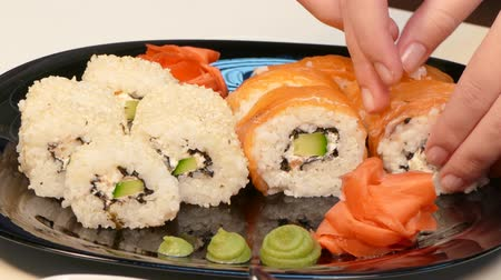 васаби : Carefully lay sushi rolls on a plate.