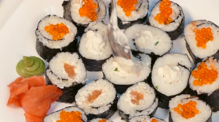 soy : To decorate sushi with red caviar and cheese.