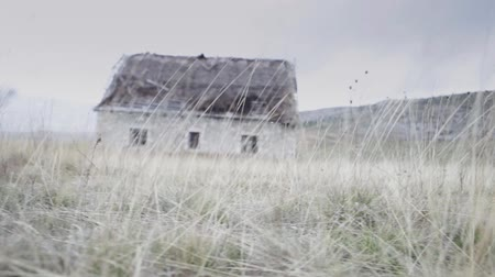 dom : Old spooky scary horror abandoned house in a middle of nowhere. Slider dolly shot