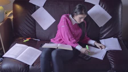 házi feladat : Beautiful woman student studying and using calculator,expressing happiness