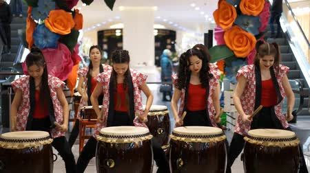 uniqlo : Moscow, Russia - March 4, 2017: group of Japanese Taiko drummers girls perform in Oceania shopping center on the at the opening of a new store UNIQLO Unique Clothing Warehouse.