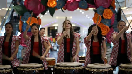drumbeat : Moscow, Russia - March 4, 2017: group of Japanese Taiko drummers girls perform in Oceania shopping center on the at the opening of a new store UNIQLO Unique Clothing Warehouse.