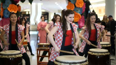 uniqlo : Moscow, Russia - March 5, 2017: group of Japanese Taiko drummers girls perform in Oceania shopping center on the at the opening of a new store UNIQLO Unique Clothing Warehouse.