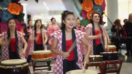 drumbeat : Moscow, Russia - March 5, 2017: group of Japanese Taiko drummers girls perform in Oceania shopping center on the at the opening of a new store UNIQLO Unique Clothing Warehouse.