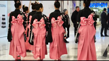 quimono : Moscow, Russia - March 24, 2017: group of japanese geishas in traditional japanese kimono go away in a mall Rivierra. The performance dedicated to the new japanese Uniqlo store in Moscow.