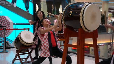 drumbeat : Moscow, Russia - March 25, 2017: group of Japanese Taiko drummers girls perform in Kaleidoscope shopping center at the opening of a new store UNIQLO Unique Clothing Warehouse.