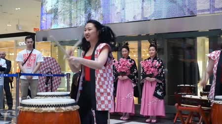 taiko drums : Moscow, Russia - March 24, 2017: group of Japanese Taiko drummers girls perform in Riviera shopping center at the opening of a new store UNIQLO Unique Clothing Warehouse.