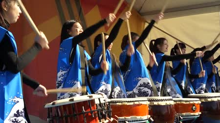 drumbeat : Moscow, Russia - May 14, 2017: Group of taiko drummer girls One in the field warrior Taiko inspiration performs on the festival of martial arts. Stock Footage