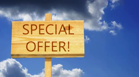 reklama : Special offer words on a wooden sign