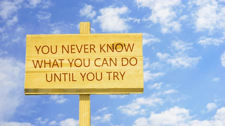 conversa : You never know what you can do until you try. Words on a wooden sign. Vídeos