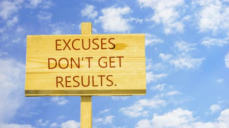 siker : Excuses do not get results. Words on a wooden sign.