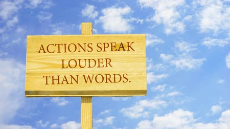 provérbio : Actions speak louder than words. Words on a wooden sign.