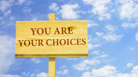 judgment day : You are your choices. Words on a wooden sign.