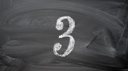 chalky : Chalky numbers, direct countdown 0-9. Ten arabic numerals handwritten with white chalk on a blackboard. Stock Footage