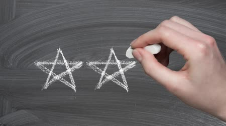 five stars : Feedback concept, woman drawing rating stars on blackboard Stock Footage