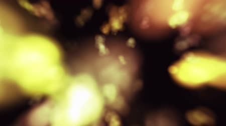 shimmer : Shimmering yellow blurred holiday confetti on a black background for overlay.