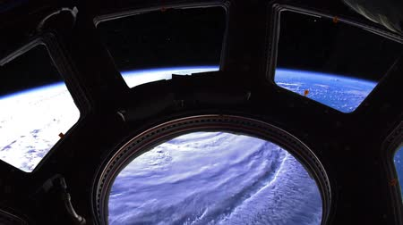 spaceship : Hurricane Florence, satellite view video through the porthole. Elements of this image furnished by NASA. Stock Footage