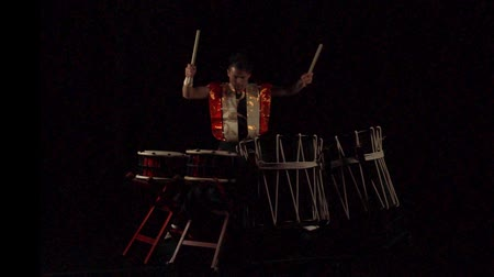 taiko drums : Full length portrait of a Japanese drummer Taiko drum on a dark stage. Stock Footage